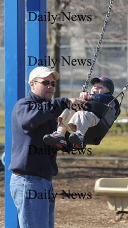 Newburyport: Jason Blunt gives his son Aidan, 3, a push on the swings at Cashman Park Sunday.photo by Jim Vaiknoras. Newburyport Daily News  Sunday March 8, 2009