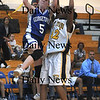 Boston:Georgetown'sMichelle Reilly glides in for two past Nyesha Kelley during the Royals North Finals victory over New Mission at Emmanuel College in Boston.photo by Jim Vaiknoras March 7 2009