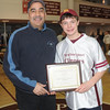 Newburyport: The winner of the Newburyport Boys Basketball Association Frank Cousins Award 8th grader Ryan Short poses with Frank at Newburyport High Sunday .Jim Vaiknoras/staff photo