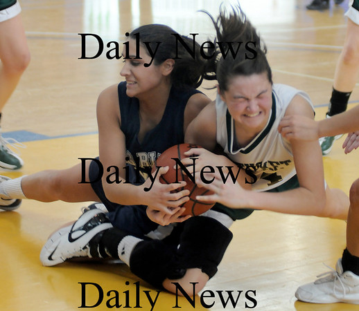 Boston: Pentucket's Andrea Attenasio fights for a loose ball with Swampscott's Tara Nimkar during the Sachems 61-46 loss to Swampscott in the North final at Emmanuel College in Boston Saturday photo by Jim Vaiknoras March 7, 2009