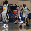 Boston:Georgetown's Shannon Hartford looks to pass from her knees after making a steal during the Royals North Finals victory over New Mission at Emmanuel College in Boston.photo by Jim Vaiknoras March 7 2009