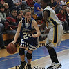 Boston:Georgetown's Pauline Reilly drives past Bianca Flores during the Royal North Finals victory over New Mission at Emmanuel College in Boston.photo by Jim Vaiknoras March 7 2009