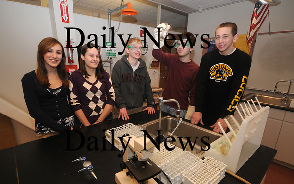 Newburyport:Newburyport high science fair winners, from left; Taylor Burl, 15, Jessie Clayton , 15, Max Handler, 16, Tony Dube, 17, and Alec MacDougall pose at one of the science labs at newburyport high,photo by Jim Vaiknoras. Newburyport Daily News. March 5, 2009