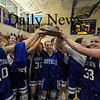 Boston:The Georgetown girls basketball team hold up their trophy after their North Finals victory over New Mission at Emmanuel College in Boston.photo by Jim Vaiknoras March 7 2009