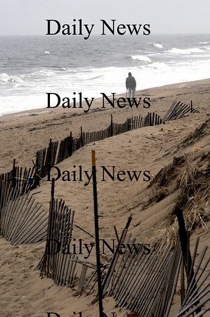 Newbury: A man braves the cold wind to take a walk on Plum Island Beach Sunday morning.Jim Vaiknoras/staff photo