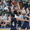 Boston: Pentucket's Ashley Viselli splits the defence to two during the Sachems 61-46 loss to Swampscott in the North final at Emmanuel College in Boston Saturday photo by Jim Vaiknoras March 7, 2009