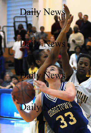 Boston:Georgetown'sTaryn O'Connell drives past Tieasia Kemp during the Royal North Finals victory over New Mission at Emmanuel College in Boston.photo by Jim Vaiknoras March 7 2009