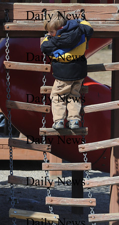 Amesbury: Drew Sliwkowski, 3, of Amesbury takes a looks down as he climbs the ladder at Amesbury Park on the first day of spring. Jim Vaiknoras/Staff photo