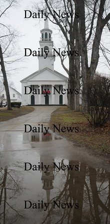 Amesbury: The Main Street Congregational Church in Amesbury is reflected in rain water on it's walkway Sunday afternoon.Jim Vaiknoras/Staff photo