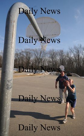 Newbury:Jess Savage , 12, drives to the basket behind the Newbury Elementary School while playing a little one on one Saturday. Jim Vaiknoras/Staff photo