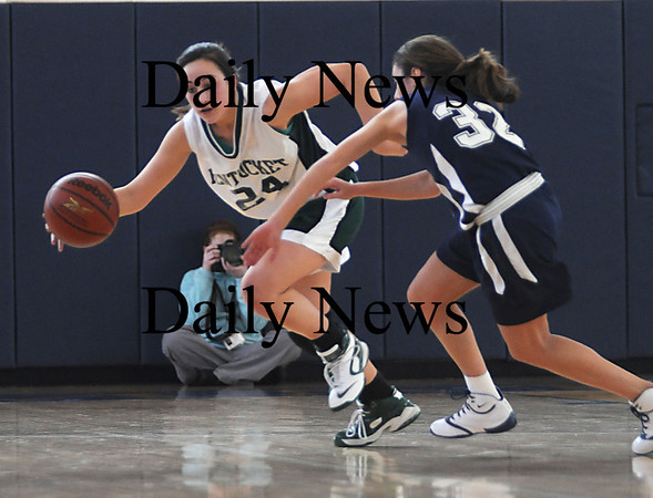 Boston: Pentucket's Ashley Viselli drives past Kara Gilberg during the Sachems 61-46 loss to Swampscott in the North final at Emmanuel College in Boston Saturday photo by Jim Vaiknoras March 7, 2009