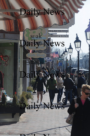 Newburyport: Shoppers enjoy the warm weather as they stroll down State Street in Newburyport Saturday. Jim Vaiknoras/ Staff photo