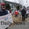 Newburyport: Newburyport resident Frank Cashman holds a sign Saturday outside Newburyport City Hall.Jim Vaiknoras/staff photo