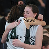 Boston: Pentucket's Erin McNamara is consoled by teammate Andrea Attenasio after the Sachems 61-46 loss to Swampscott in the North final at Emmanuel College in Boston Saturday photo by Jim Vaiknoras March 7, 2009