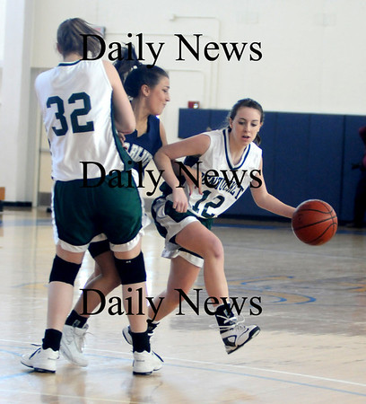 Boston: Pentucket's Kirsten Daamen sets a pick for teammate Erin McNamara during the Sachems 61-46 loss to Swampscott in the North final at Emmanuel College in Boston Saturday photo by Jim Vaiknoras March 7, 2009
