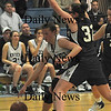 Methuen:Pentucket's Kirsten Daamen makes a move on St Mary's Tori Faienta during the Sachems 38-27 win at Methuen High Thursday night. photo by Jim Vaiknoras Newburyport Daily News, Thursday March 5, 2009