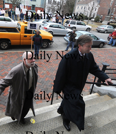 Newburyport:Congressman  John Teirney walks past protesters in Brown Square as he enters Newburyport City Hall Saturday.Jim Vaiknoras/staff photo
