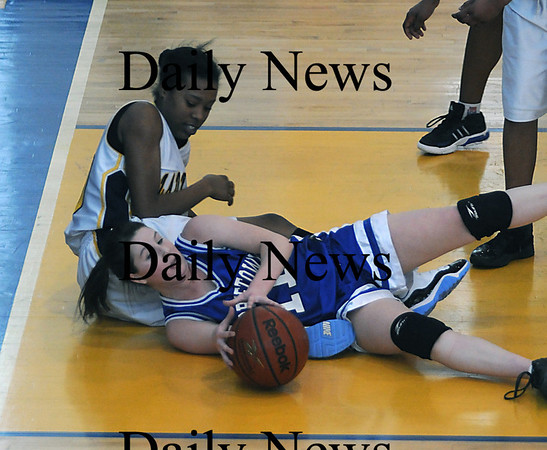 Boston:Georgetown's Shannon Hartford looks to pass after grabbing a loose ball during the Royals North Finals victory over New Mission at Emmanuel College in Boston.photo by Jim Vaiknoras March 7 2009