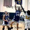 Boston:Georgetown's Gina DeGenova dives to the hoop past Shacora Williams during the Royal North Finals victory over New Mission at Emmanuel College in Boston.photo by Jim Vaiknoras March 7 2009