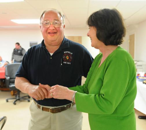 Byfield: Newly elected Newbury selectman Michael Bulgaris is congratulated by his campaign organizer, Evelyn Noyes, at the Byfield Fire Station. Bryan Eaton/Staff Photo Newburyport News  Tuesday May 12, 2009.