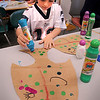 Salisbury: Louis Bishop, 6, decorates the tail of a fish he cut out Thursday  afternoon at the Salisbury Elementary School. The kindergartners were learning different things about the Earth's oceans and did some illustrations. Bryan Eaton/Staff Photo  Newburyport News  Thursday May 28, 2009.