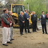 Salisbury: State and local officials met near a pile of railroad ties, left, to laud the beginning of construction of the Salisbury Eastern Marsh Rail Trail. From left, Salisbury Planning Board Chairman Bob Straubel, DPW head Don Levesque, Rep. Michael Costello, town manager Neil Harrington, state transportation secretary James Aloisi, Sen. Steve Baddour, Steve Early of S & R Construction, Salisbury selectmen chairman Jerry Klima and Mary Williamson, of Essex National Heritage Commission. Bryan Eaton/Staff Photo  Newburyport News  Thursday May 7, 2009.
