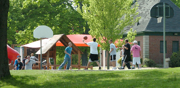 Amesbury: Nice weather brough a lot of people out to Amesbury Town Park yesterday including this group of pickup basketball players. Bryan Eaton/Staff Photo Newburyport News  Tuesday May 12, 2009.