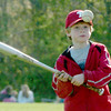 Byfield: Sean Reagan, 8, has his eye on a ball he tossed up and tries to hit at the Triton baseball field yesterday. The Amesbury fan was there with his grandfather, Roger Beaulieu, who keeps score for the Indians.