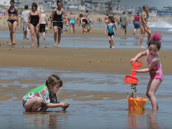 Salisbury: Shae Silva, 5, left, of Methuen and Alyse Pelletier, 4, of Windham, N.H., play in a small pool of water between the beach and a sandbar. The two were among the hundreds that fled to Salisbury Beach State Reservation yesterday. Bryan Eaton/Staff Photo  Newburyport News  Thursday May 21, 2009.