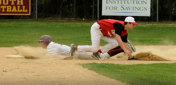 Newburyport: Newburyport's Thomas Morris makes it safely past Masconomet's Splinter on a bunt by Ryan O'Connor.  Bryan Eaton/Staff Photo Newburyport News  Monday May 4, 2009.