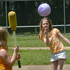 Salisbury: Sheridyn LaRocque tosses a ball to Eve Paicos, both 7, as they learn different eye-to-hand skills in Linda Gangemi's outdoor gym class at Salisbury Elementary School on Tuesday. Gym classes may head indoors as scattered rain is expected for the rest of the week. Bryan Eaton/Staff Photo  Newburyport News  Tuesday May 26, 2009.