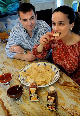 Newburyport: Newburyport resident Joseph Muscarella and his wife, Antonella, have created two hot sauces. Bryan Eaton/Staff Photo  Newburyport News  Friday May 1, 2009.