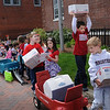 "Newburyport: Kindergarten and pre-kindergartners from the Brown School walked to the Newburyport Post Office on Monday where they were met by Postmaster Leo ""Scott"" Murray where they delivered ""care packages"" for Newburyport residents who are active duty in the military. Many Brown school families donated money for the items, including phone cards, and the costs of postage. The community service project which honors the soldiers hopes they receive them by Memorial Day. Bryan Eaton/Staff Photo  Newburyport News  Monday May 11, 2009."