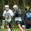 West Newbury: Pentucket's Dylan Chase moves down field with Triton's Mike Foley moving in. Bryan Eaton/Staff Photo  Newburyport News  Thursday May 7, 2009.