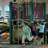 Newburyport: The Tot Lot on Inn Street in Newburyport has been full of energy as children and their parents have been there in force this week. The story should remain as such through the weekend as temperatures will  be in the 70's. Bryan Eaton/Staff Photo  Newburyport News  Wednesday May 13, 2009.