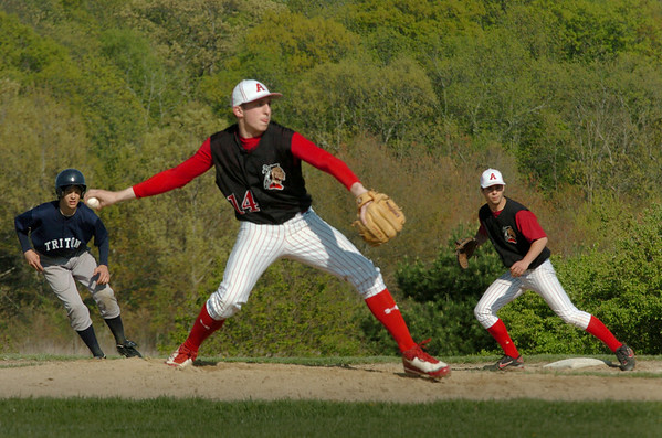 Byfield: Triton's Tom Kuzcar leads on Amesbury first baseman Jake Conant as pitcher James Paradis readies to throw. Bryan Eaton/Staff Photo Newburyport News  Tuesday May 12, 2009.