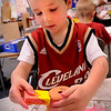 Salisbury: James Tatro, 5, uses a sponge to texture paint onto a flower pot in kindergarten class at Salisbury Elementary School on Wednesday. The children are going to also plant flowers in them to take home as a gift for Mother's Day. Bryan Eaton/Staff Photo  Newburyport News  Wednesday May 6, 2009.