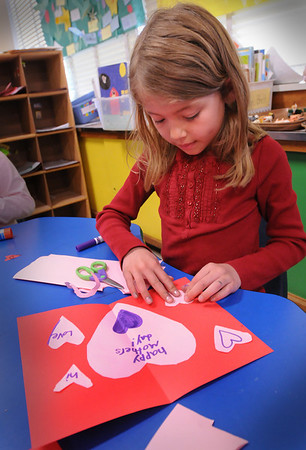 Newburyport: Sidney Ficht, 7, works on a Mother's Day card in Barbara Ahern's first grade class at the Bresnahan School on Thursday morning. Bryan Eaton/Staff Photo  Newburyport News  Thursday May 7, 2009.