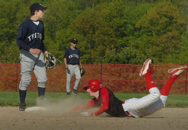Byfield: Amesbury's James Paradis is late to second plate as Triton shortstop Richard Fecteau made a double play. Bryan Eaton/Staff Photo Newburyport News  Tuesday May 12, 2009.
