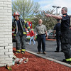 Amesbury: Amesbury building inspector Dennis Nadeau, center, checks out the rear of Friendly's restaurant in Amesbury which was hit by a vehicle yesterday afternoon, just missing the gas meter. Bryan Eaton/Staff Photo  Newburyport News  Wednesday May 6, 2009.