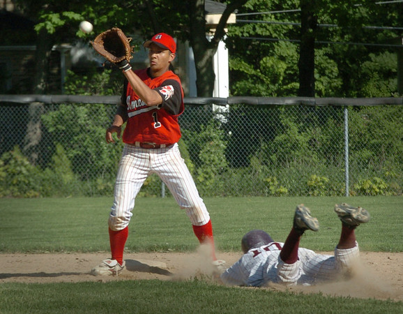 Newburyport: Amesbury shortstop Joe Meija waits for the throw as Newburyport's Joe Clancy makes a successful steal. Bryan Eaton/Staff Photo Newburyport News Tuesday May 19, 2009.