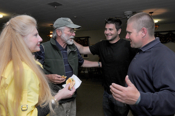 Newbury: Geoff Walker is congratulated by his wife, Josette, and sons, Nathan, right and Josh last night at the Ould Newbury Golf Club after getting elected Newbury selectman. Bryan Eaton/Staff Photo Newburyport News  Tuesday May 12, 2009.