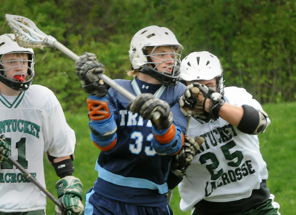 West Newbury: Triton's Caleb Woodworth looks to score against Pentucket yesterday. Bryan Eaton/Staff Photo  Newburyport News  Thursday May 7, 2009.