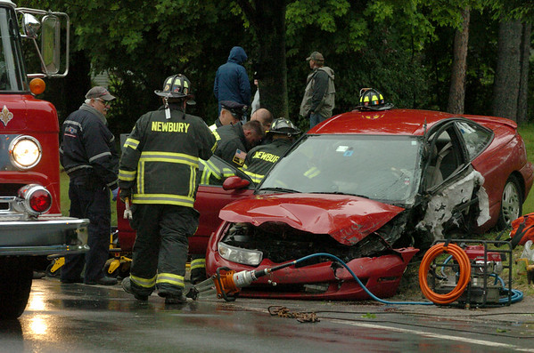 Newbury: Rescue personnel remove the occupant of this car that was involved in a collision with black pickup truck yesterday afternoon on Route 1A in Newbury near Tendercrop Farm. Bryan Eaton/Staff Photo Newburyport News  Wednesday May 25, 2009.