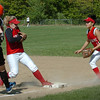 Amesbury: Amesbury second baseman Kerri Salvatore steps onto first base forcing this Ipswich player out as first baseman Leah Guilmette covers. Bryan Eaton/Staff Photo Newburyport News  Tuesday May 12, 2009.