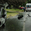 Newbury: A tire from this pickup truck lies on Route 1A in Newbury after a collision with the red car, shown in back, left yesterday afternoon. An occupant from the car had to be extricated and taken away by ambulance. Bryan Eaton/Staff Photo Newburyport News  Wednesday May 25, 2009.