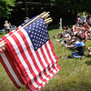 "Amesbury: Students from Amesbury Elementary School sing the ""Liberty Tree Song"" during an early Memorial Day event at Mount Prospect Cemetery. They later placed flags around the cemetery on the graves of soldiers who died for their country. Bryan Eaton/Staff Photo  Newburyport News  Thursday May 21, 2009."
