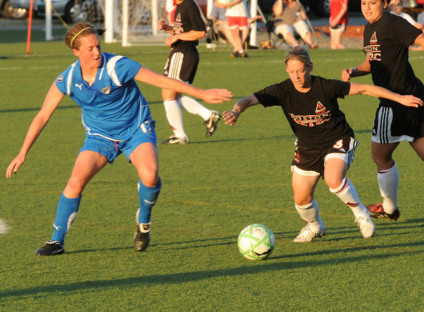 Amesbury: Boston Breakers Kasey Moore, left, and Boston Aztec Mary-Francis Monroe move in on a loose ball. Bryan Eaton/Staff Photo  Newburyport News  Thursday May 21, 2009.