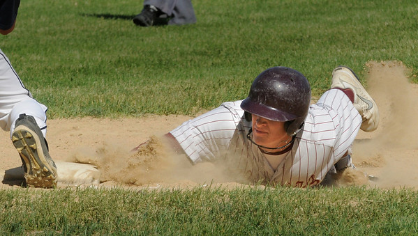 Newburyport: Tyler Stotz dives back to first base after looking to steal. Bryan Eaton/Staff Photo  Newburyport News  Thursday May 21, 2009.