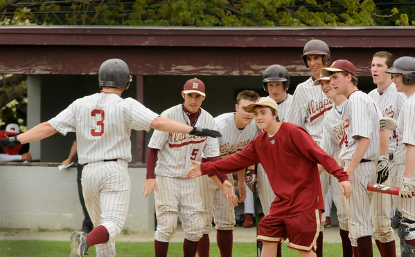 Newburyport: Kyle McElroy is greeted by teammates at homeplate after he popped the ball out of the field yesterday against Masconomet for a home run. Bryan Eaton/Staff Photo Newburyport News  Monday May 4, 2009.